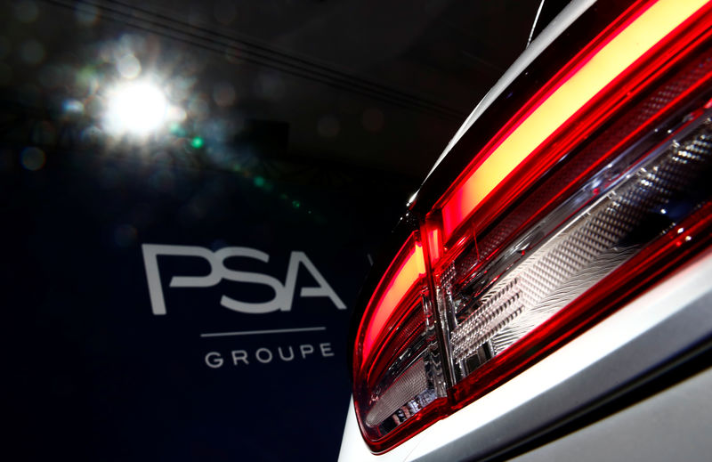 © Reuters. A PSA Group logo is seen behind a car displayed during French carmaker's news conference as they announce the company's 2018 results at their headquarters in Rueil-Malmaison