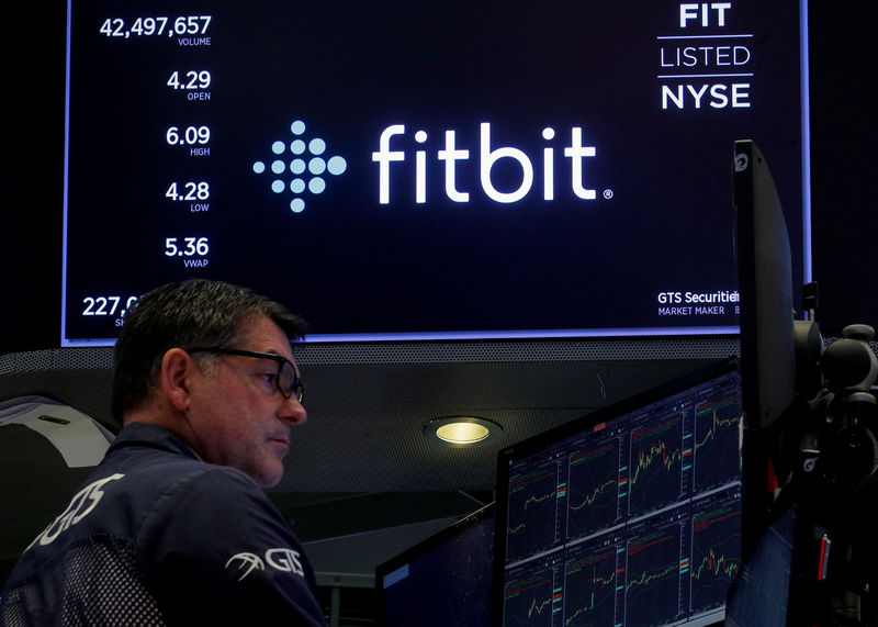 © Reuters. FILE PHOTO: The logo for wearable device maker Fitbit Inc. is displayed on a screen on NYSE floor in New York