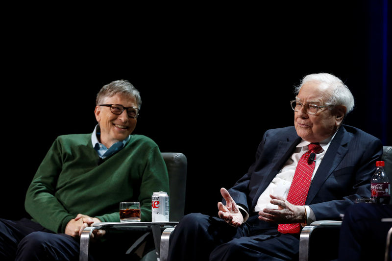 © Reuters. Warren Buffett, chairman and CEO of Berkshire Hathaway, speaks while Bill Gates looks on at Columbia University in New York