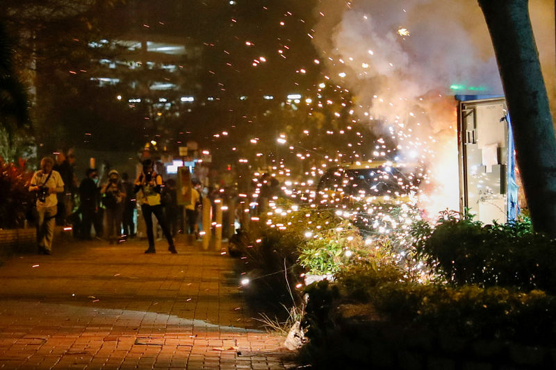 © Reuters. An electricity switch box explodes as it was set on fire by protesters, after Chow Tsz-lok, 22, a university student, died after he fell during a protest, at Tseung Kwan O, Hong Kong