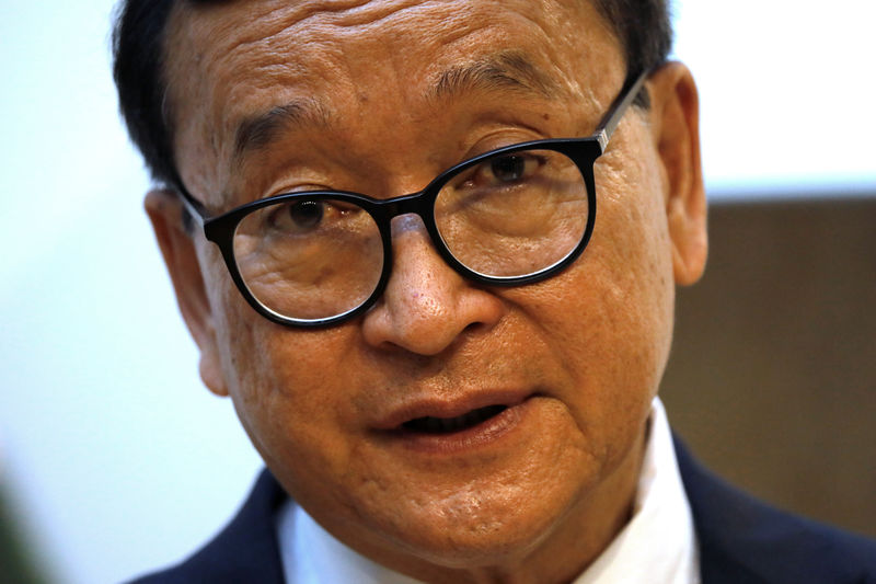 © Reuters. Self-exiled Cambodian opposition party founder Sam Rainsy attends an interview with Reuters in Paris