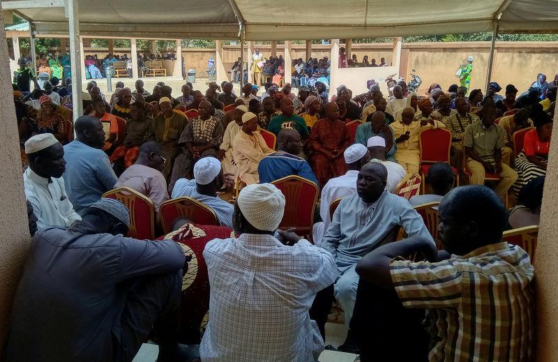 © Reuters. Family members wait outside a morgue in Ouagadougou