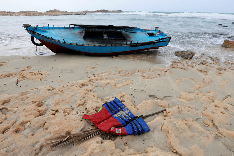 © Reuters. FILE PHOTO: A boat used by migrants is seen near the western town of Sabratha