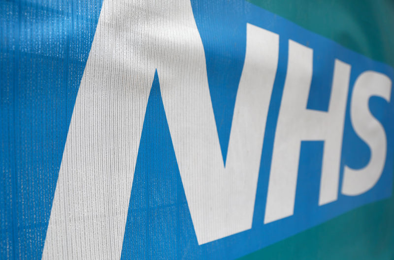 © Reuters. FILE PHOTO: An NHS logo is displayed outside a hospital in London