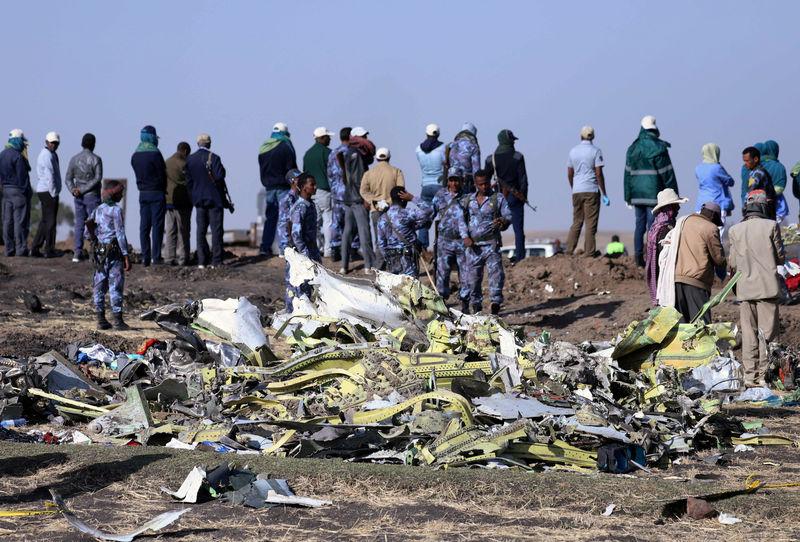 Last remains of Ethiopian plane crash victims buried, families say lit
