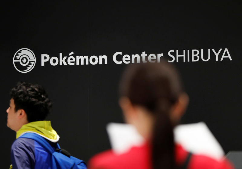 © Reuters. Visitors are seen at Pokemon Center Shibuya during a press preview in Tokyo, Japan