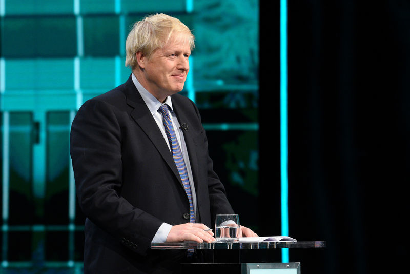 © Reuters. FILE PHOTO: First televised head to head debate between Johnson and Corbyn ahead of election