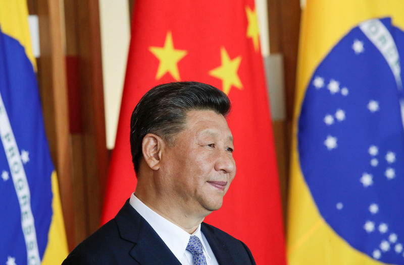 China's Xi says he wants to work out initial trade deal with U.S. By R