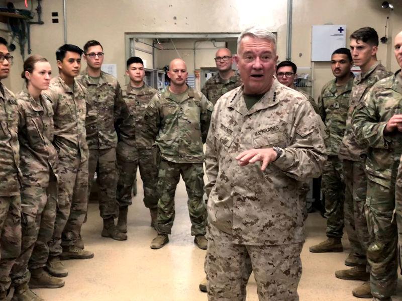 © Reuters. FILE PHOTO: Marine General Kenneth McKenzie speaks with U.S. troops while visiting Forward Operating Base Fenty in Jalalabad, Afghanistan
