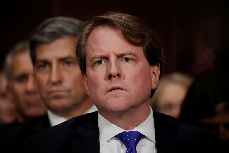 © Reuters. FILE PHOTO: White House coounsel Don Mcgahn listens to U.S. Supreme Court nominee Kavanaugh testify at his Senate Judiciary Committee confirmation hearing on Capitol Hill in Washington
