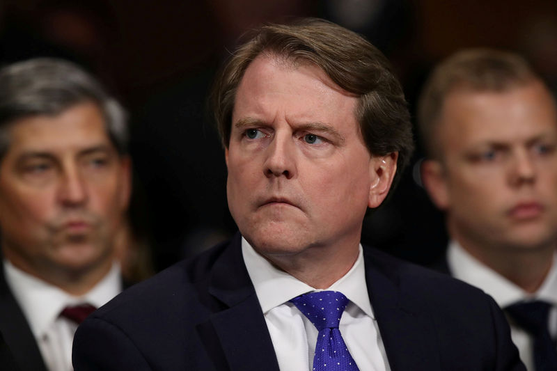 © Reuters. FILE PHOTO: White House Counsel Don McGahn listens to Judge Brett Kavanaugh as he testifies before the Senate Judiciary Committee during his Supreme Court confirmation hearing in the Dirksen Senate Office Building on Capitol Hill