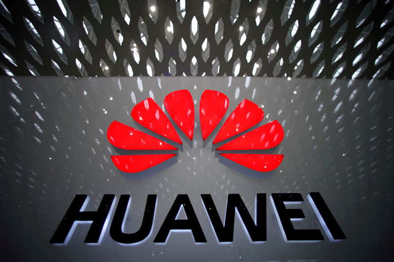© Reuters. FILE PHOTO: A Huawei company logo is pictured at the Shenzhen International Airport in Shenzhen
