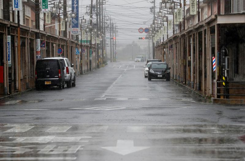 © Reuters. An empty road leading into Shiroko, Suzuka, Japan October 12, 2019, seen in heavy rain ahead of Typhoon Hagibis