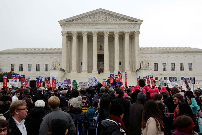 U.S. Supreme Court justices lean toward insurers on $12 billion Obamac