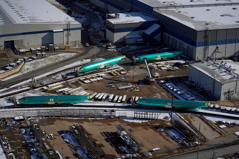 © Reuters. FILE PHOTO: Airplane fuselages bound for Boeing's 737 Max production facility await shipment on rail sidings at their top supplier, Spirit AeroSystems Holdings Inc, in Wichita