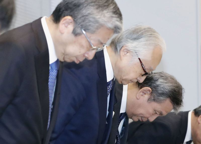 Heads of three Japan Post firms to resign over improper policy sales: media