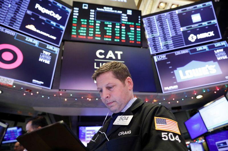 Nasdaq tops 9,000 on boosts from Amazon, trade optimism