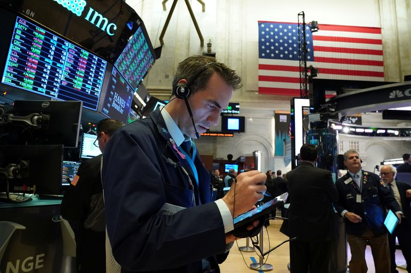Wall St. brushes off Middle East tensions as tech-related shares gain