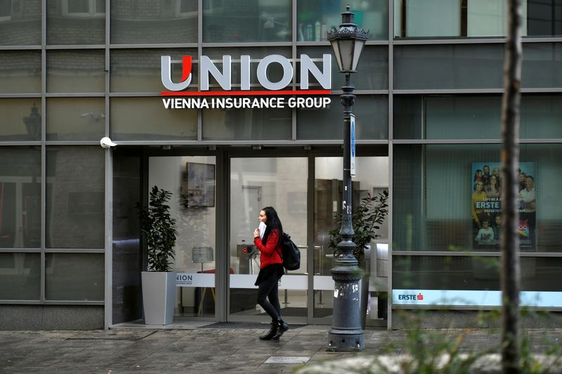 © Reuters. People walk past insurance company Union HQ in Budapest