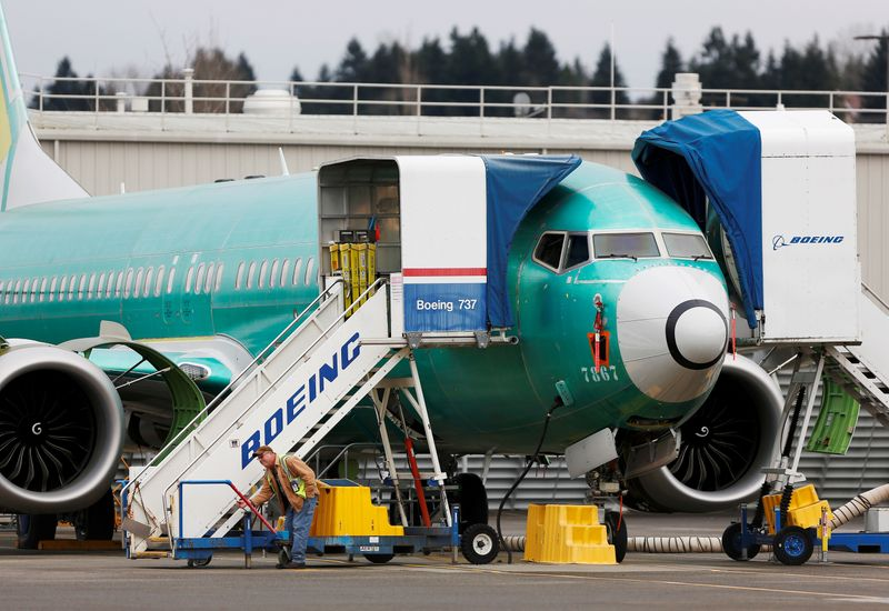 © Reuters. FILE PHOTO: An employee works near a Boeing 737 Max aircraft at Boeing's 737 Max production facility in Renton, Washington