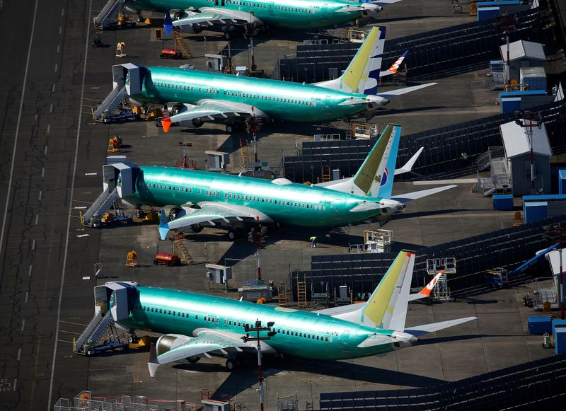 © Reuters. Unpainted Boeing 737 MAX aircraft are seen parked at Renton Municipal Airport in Renton