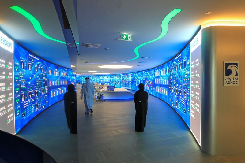 © Reuters. Employees are seen at the Panorama Digital Command Centre at the ADNOC headquarters in Abu Dhabi