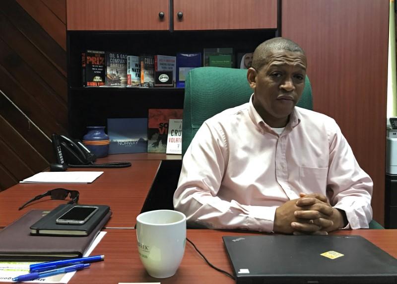 © Reuters. Mark Bynoe, the director of Guyana's Department of Energy, talks to Reuters in Georgetown