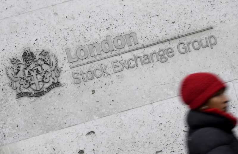 © Reuters. A woman walks past the London Stock Exchange building in the City of London, Britain