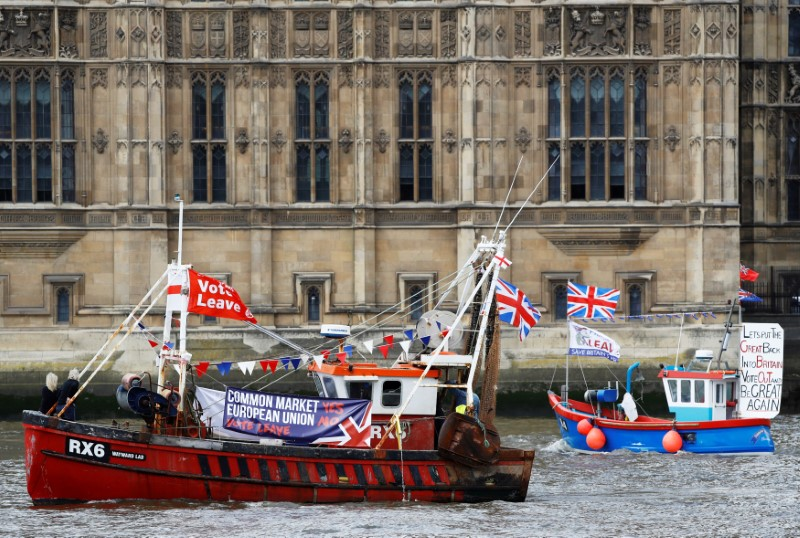© Reuters. FILE PHOTO: Part of a flotilla of fishing vessels campaigning to leave the European Union sails past Parliament on the river Thames in London