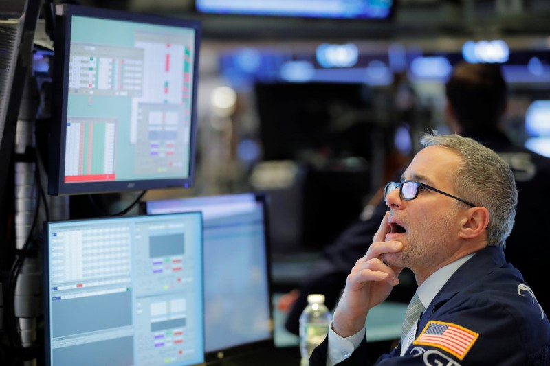 © Reuters. A trader works on the floor of the New York Stock Exchange shortly after the opening bell in New York