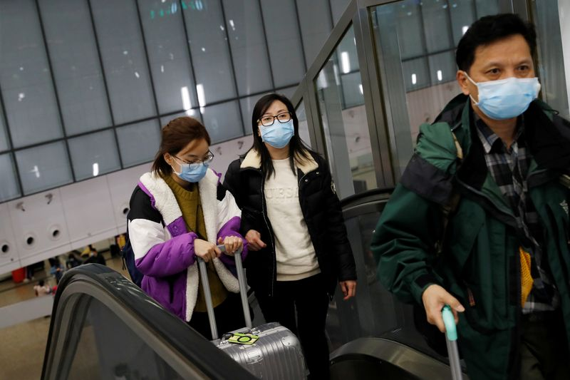 Hong Kong unions threaten strikes in push for border closure to curb virus