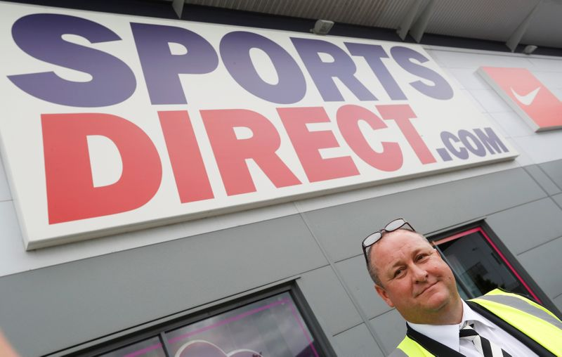 © Reuters. FILE PHOTO: Mike Ashley, founder and majority shareholder of sportwear retailer Sports Direct, leads journalists on a factory tour after the company's AGM, at the company's headquarters in Shirebrook