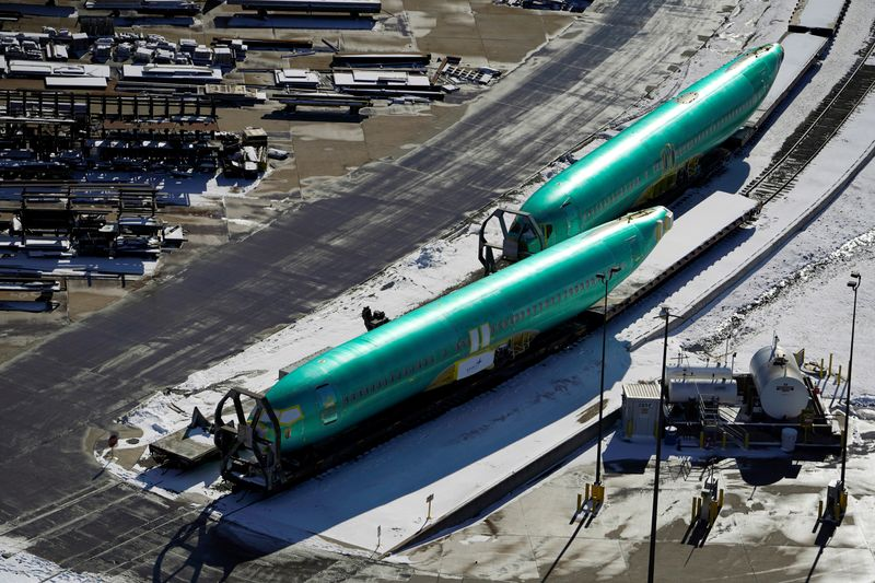 © Reuters. Airplane fuselages bound for Boeing's 737 Max production facility await shipment on rail sidings at their top supplier, Spirit AeroSystems Holdings Inc, in Wichita