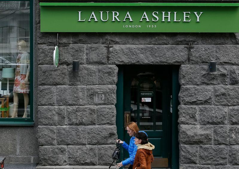 © Reuters. People walk past Laura Ashley store in Kiev