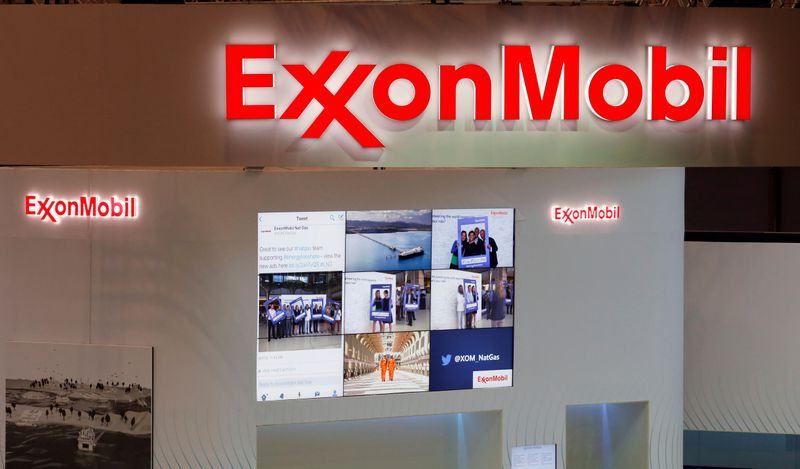 © Reuters. FILE PHOTO: Logos of ExxonMobil are seen in its booth at Gastech, the world's biggest expo for the gas industry, in Chiba