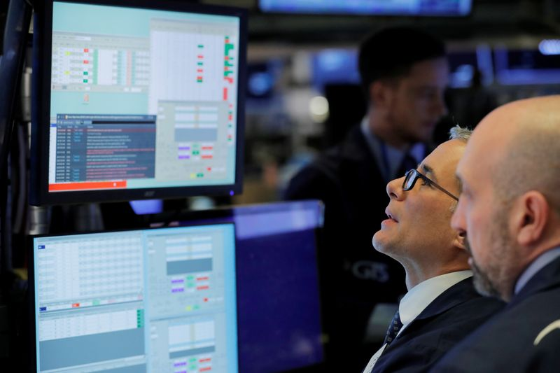 Wall Street rebounds from virus fears, helped by factory strength and tech stocks