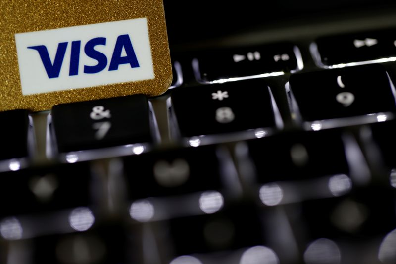 © Reuters. A Visa credit card is seen on a computer keyboard in this picture illustration