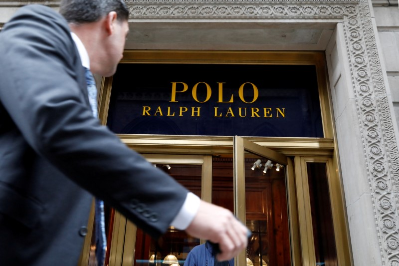 © Reuters. FILE PHOTO: A man walks past Ralph Lauren Corp.'s flagship Polo store on Fifth Avenue in New York