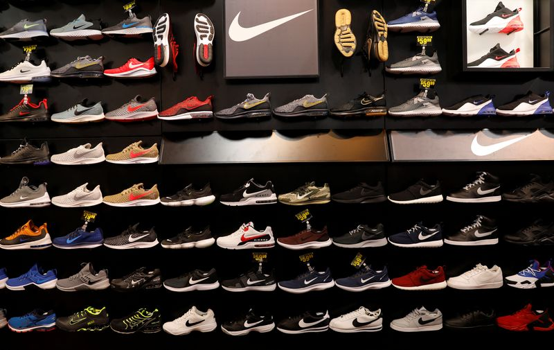 © Reuters. Nike shoes are seen displayed at a sporting goods store in New York