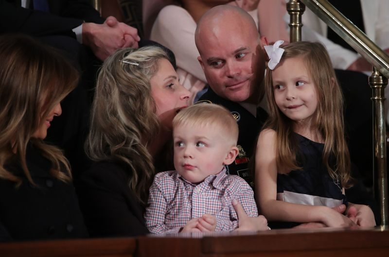 © Reuters. Sgt. 1st Class Townsend Williams surprises family at the State of the Union address by U.S. President Donald Trump in Washington
