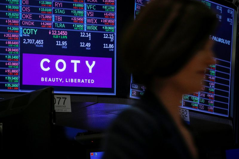 © Reuters. A screen displays the logo and trading information for Coty Inc at the NYSE in New York