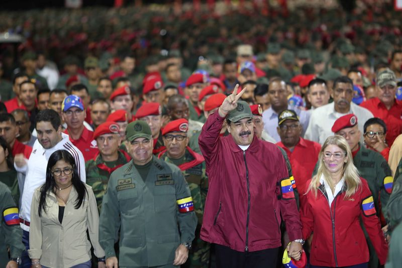 Venezuela's Maduro lets companies issue securities in hard currency