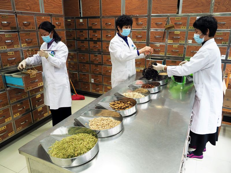 Desperate for coronavirus solutions, Chinese turn to HIV drugs, gray market and traditional cures