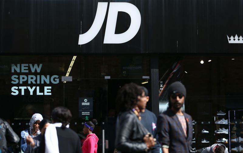 © Reuters. FILE PHOTO: People pass a JD Sports store in London