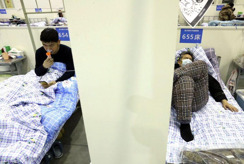 Coronavirus cases rise as recessions loom in Singapore, Japan