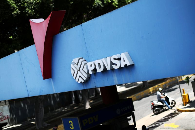 © Reuters. FILE PHOTO: Logo of state oil company PDVSA is seen at a gas station in Caracas