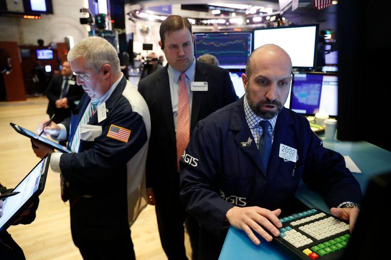 Investors prepare for more market swings as virus spreads in the U.S.