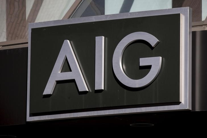 © Reuters. The AIG logo is seen at its building in New York's financial district