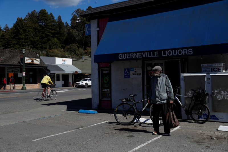 © Reuters. A man stands outside a liquor store in Guerneville, California
