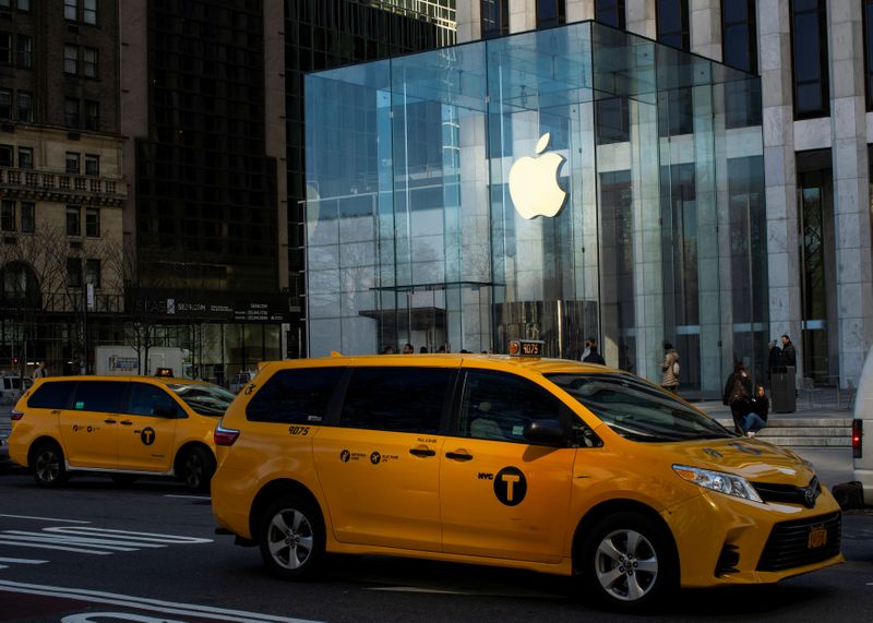 © Reuters. A cab drives down 5av while Apple store is seen closed to public due to COVID-19 in New York City, New York